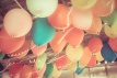 Colorful balloons floating on the ceiling of a party in vintage color