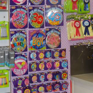 A wide range of celebration badges are available in store